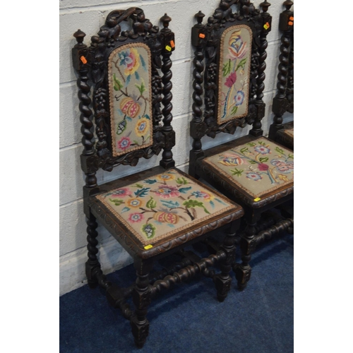 1282 - A SET OF FOUR EARLY 20TH CENTURY CARVED OAK DINING CHAIRS with needlework upholstery...