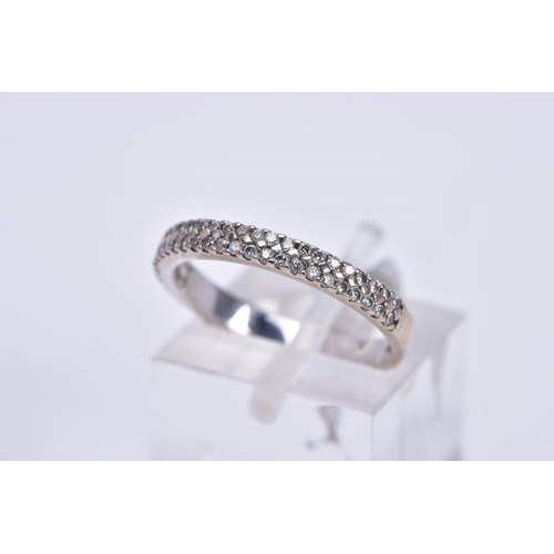 14 - AN 18CT WHITE GOLD DIAMOND RING, a half hoop design set with two rows of claw set round brilliant cu...