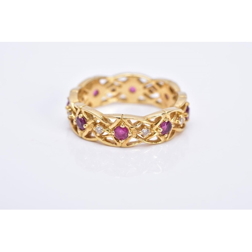 19 - AN 18CT GOLD RUBY AND DIAMOND WIDE BAND RING, of openwork design set with alternating circular cut r...