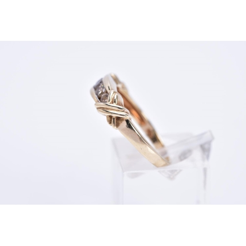 2 - A 9CT GOLD FIVE STONES DIAMOND RING, designed with five graduated round brilliant cut diamond, rub o...
