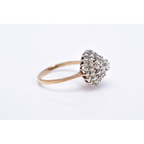 20 - A 9CT GOLD DIAMOND CLUSTER RING, the tiered cluster with a central round brilliant cut diamond and s...