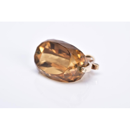 23 - A YELLOW METAL CITRINE FOB, large faceted citrine, scroll detail mount, stamped 9ct, length 22mm, ap...