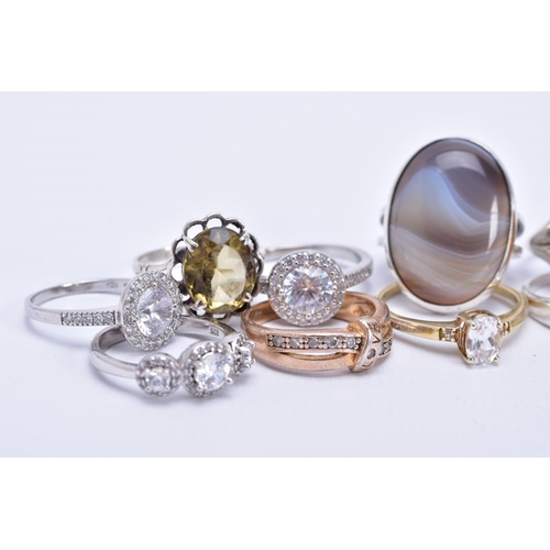 27 - AN ASSORTMENT OF GEM SET RINGS, to include nine rings such as a silver oval agate ring, hallmarked E...
