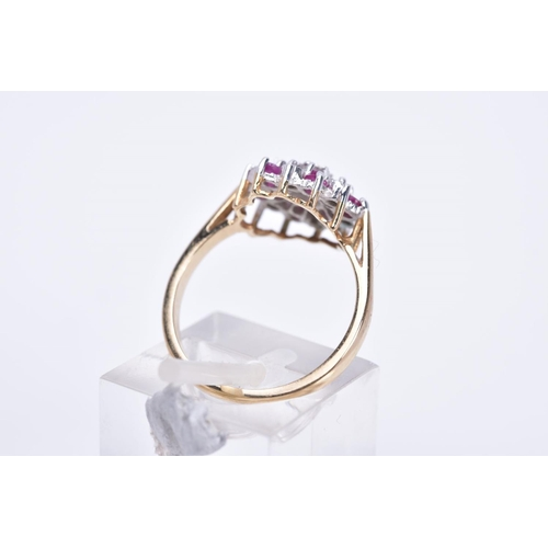 3 - A 9CT GOLD RUBY AND DIAMOND CLUSTER RING, of tiered design, illusion set single cut diamonds and cir...