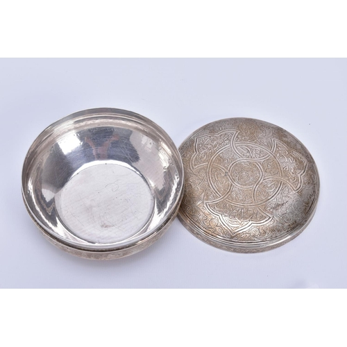 31 - A SILVER EMBOSSED LIDDED BOX, of circular design, floral and scroll detailing to the lid, Pre 1946, ...