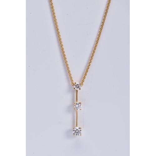 34 - A MODERN 18CT GOLD THREE STONE DIAMOND DROP PENDANT, three modern round brilliant cut diamonds gradu...