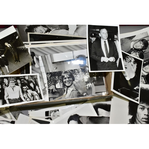 367 - POP MUSIC PHOTOGRAPHS, a collection of over one hundred press/agency photographs of Music personalit...