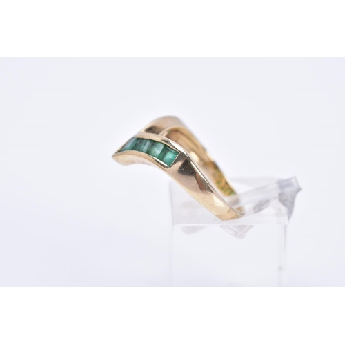 4 - A 9CT GOLD EMERALD RING, of 'v' shape design set with square cut emeralds, plain polished band, hall...