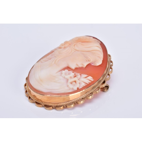40 - A MODERN 9CT GOLD CAMEO SHELL BROOCH, depicting a maiden in profile, measuring approximately 46mm x ...