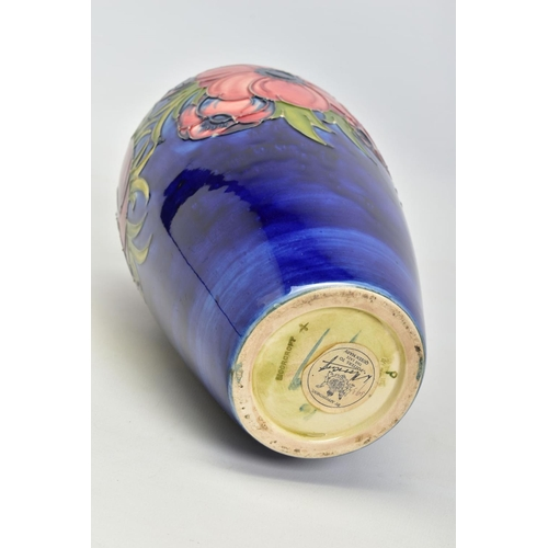 413 - A MOORCROFT POTTERY BALUSTER VASE, 'Anemone' pattern  on blue ground, impressed backstamp and Queen ...