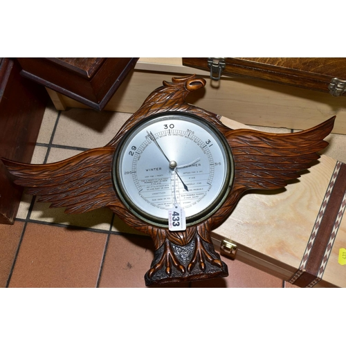433 - AN EARLY /MID 20TH CENTURY BAROMETER, set in a carved wooden case modelled as an Eagle, with silvere...