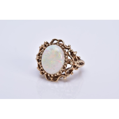 47 - A LATE 20TH CENTURY 9CT GOLD OPAL SINGLE STONE RING, opal measuring approximately 14.5mm x 11.5mm, h...