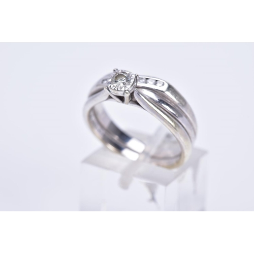 48 - A 9CT WHITE GOLD DIAMOND SOLITAIRE RING AND CROSSOVER ETERNITY RING, which have been soldered togeth...