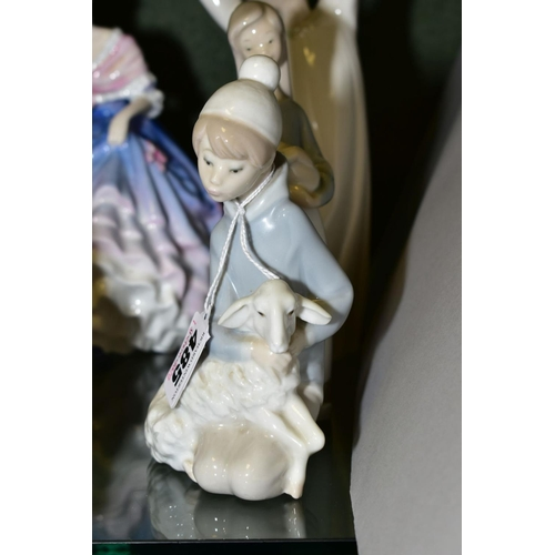 485 - THREE LLADRO FIGURINES, comprising Kneeling Shepherd Boy with Lamb 4676, a young girl holding a pigl...