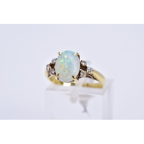 49 - A MODERN OPAL AND DIAMOND DRESS RING, opal measuring approximately 10mm x 7.5mm (condition: small ch...