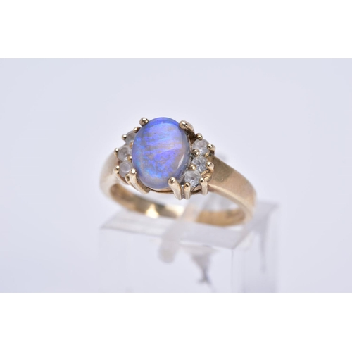 50 - A 9CT GOLD SIMULATED OPAL AND CUBIC ZIRCONIA DRESS RING, hallmarked 9ct gold, approximate gross weig...