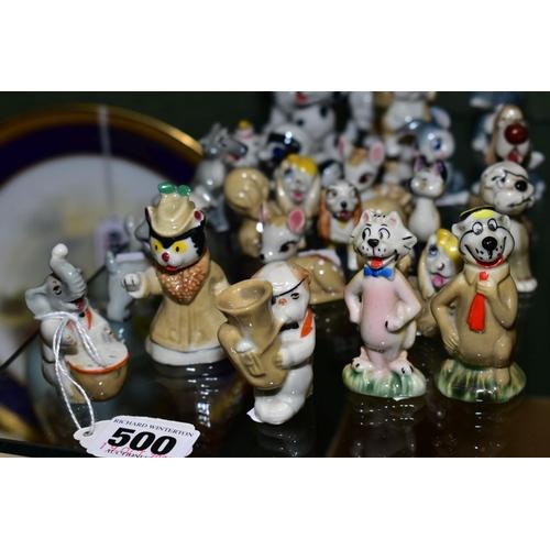 500 - TWENTY FIVE WADE WALT DISNEY YOGI BEAR AND FRIENDS AND CHARACTER FIGURES, including Drum box series ...