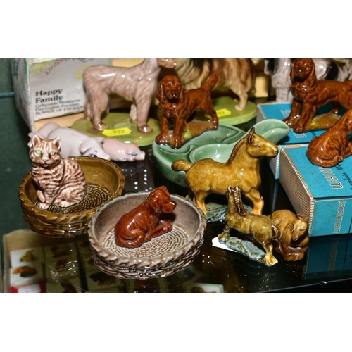 502 - A COLLECTION OF BOXED AND LOOSE WADE WHIMSIES, HAPPY FAMILY, etc, primarily cat and dog figures, inc...