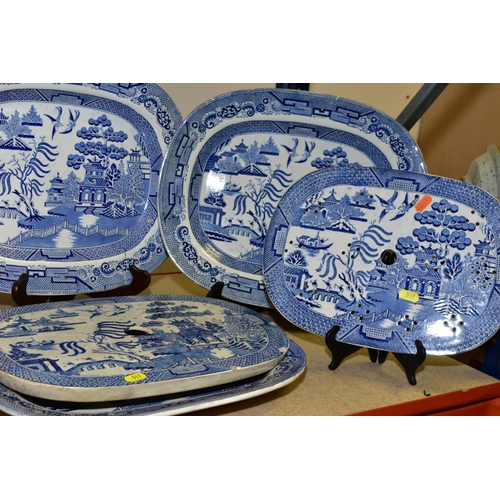 517 - FIVE WILLOW PATTERN BLUE AND WHITE PLATTERS, length approximately 41cm, two drainers, tureen with li...