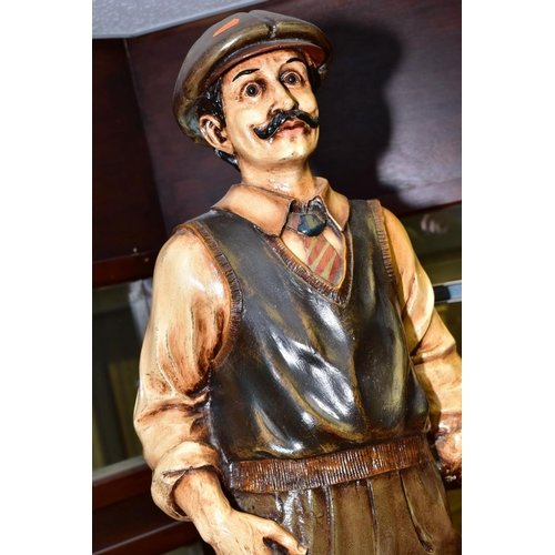 547 - A PAINTED FIBRE GLASS MODEL OF A GOLFER, posed leaning on his golf club, square base, height 96cm ap...