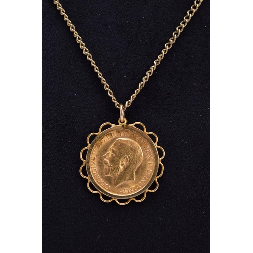 58 - A FULL SOVEREIGN PENDANT, George V dated 1911 in a later pendant mount tested as 9ct gold, together ...