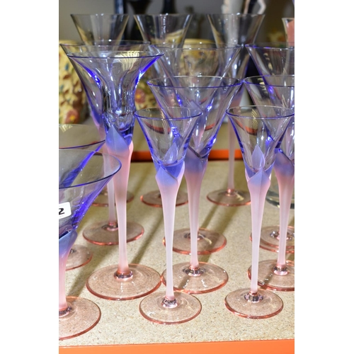 582 - A GROUP OF STUDIO GLASS, WINE GLASSES, ETC, having pink stems and foot, holding blue bowls, includin...
