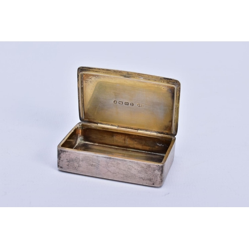 59 - A VICTORIAN SILVER SNUFF BOX, measuring approximately 50mm x 32mm, a plain case with engraved initia...