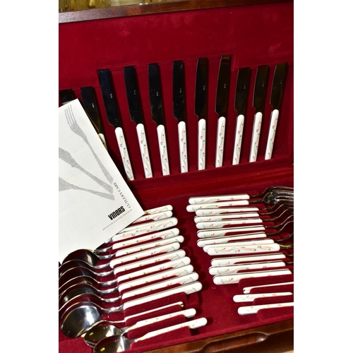 601 - A CASED VINERS STAINLESS STEEL AND MELAMINE CANTEEN OF ETERNAL BEAU PATTERN CUTLERY, for six place s...