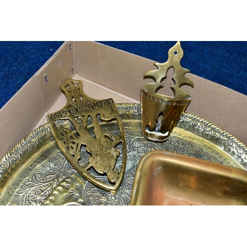 620 - A BOX OF BRASSWARE, etc, including an inkwell, two trivets, a chamberstick, two wall spill holders a...