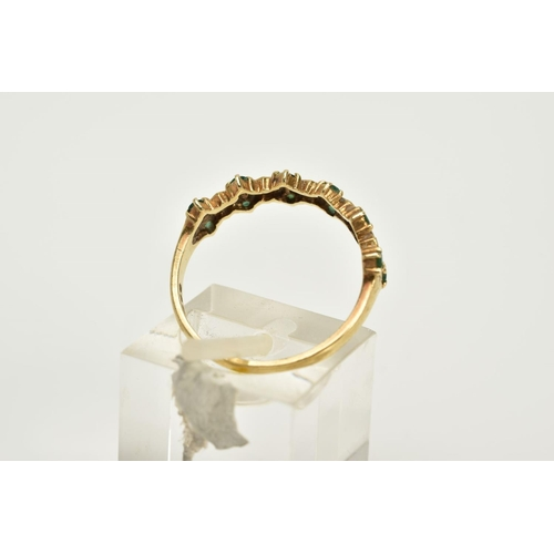 81 - A 9CT GOLD EMERALD AND DIAMOND HALF HOOP RING, designed with claw set single cut diamonds within a d...