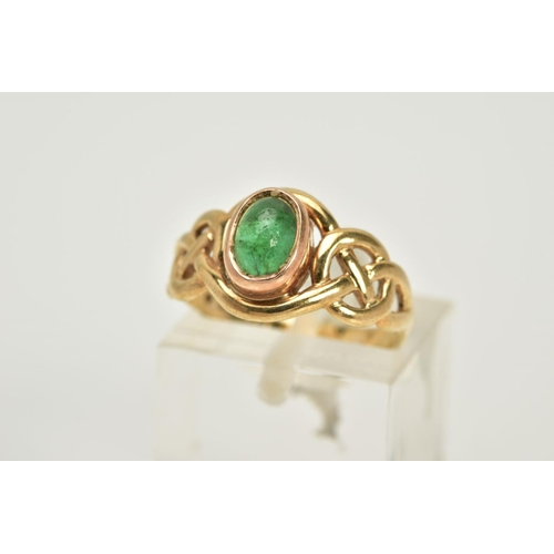 87 - A 9CT GOLD CELTIC RING, designed with a central green stone cabochon assessed as emerald within an o...