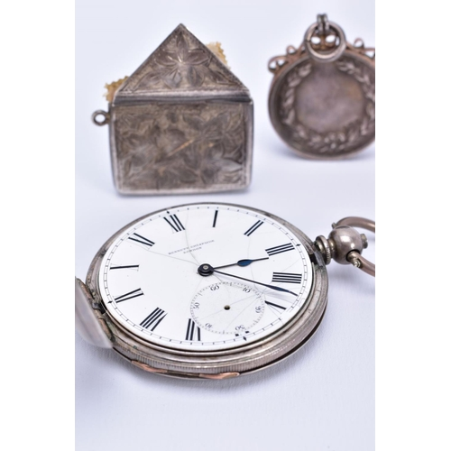 9 - A POCKET WATCH AND TWO PENDANTS, the plain polished white metal full hunter pocket watch, cracked wh...