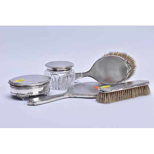 102 - AN ELIZABETH II SILVER MOUNTED FIVE PIECE DRESSING TABLE SET, all with engine turned decoration and ...