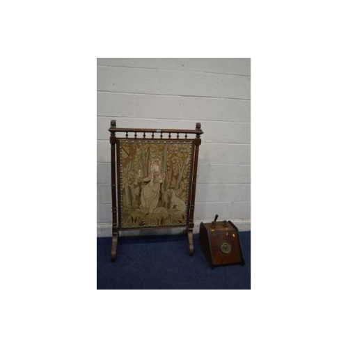 1329 - A LARGE EARLY 20TH CENTURY OAK FIRE SCREEN, with lion head's to top rail, turned and fluted upright'...