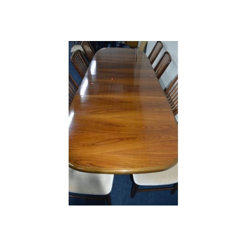 1331 - SVEND A MADSEN DANISH ROSEWOOD DINING TABLE, rounded ends on triple framed legs, two additional leav...