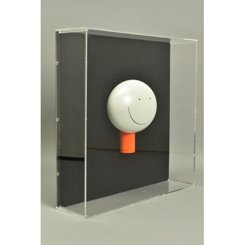 124 - DOUG HYDE (BRITISH 1972), 'The Smile', a cold cast porcelain sculpture of a smiling head, mounted wi...