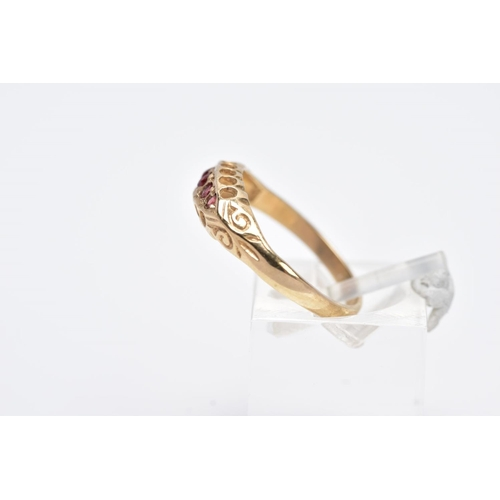 11 - A 9CT GOLD FIVE STONE RING, designed with a row of five circular cut garnets, within an openwork gal...