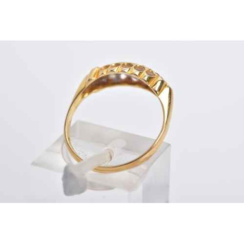 13 - AN EARLY 20TH CENTURY 18CT GOLD BOAT RING, designed with three graduated, circular cut rubies inters...