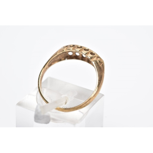 14 - A 9CT GOLD FIVE STONE BOAT RING, designed with a central single cut diamond interspaced with circula...