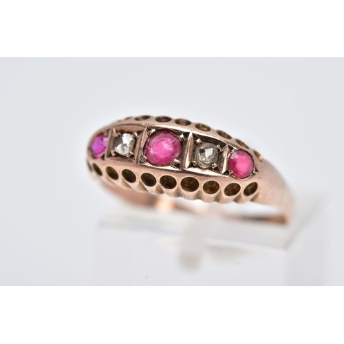 15 - AN EARLY 20TH CENTURY 9CT GOLD BOAT RING, set with two rose cut diamonds, a single circular cut ruby...