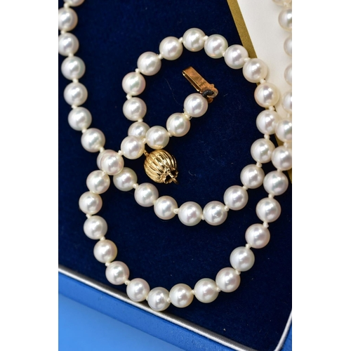 17 - A CULTURED PEARL NECKLACE, individually knotted on a white cord, each pearl approximately 4.6mm, fit...