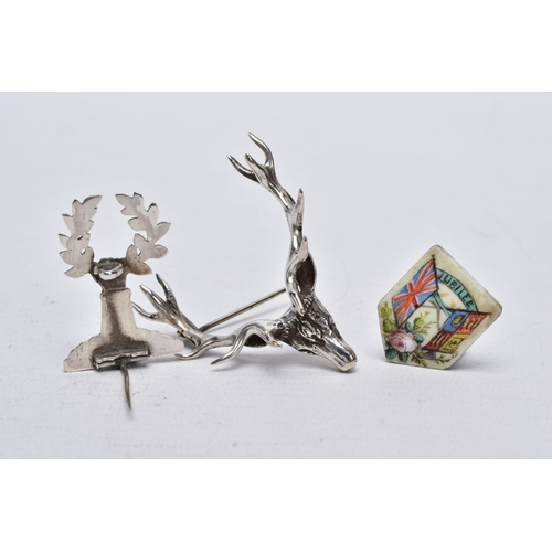 2 - TWO WHITE METAL BROOCHES AND A JUBILEE PLAQUE, the first brooch in the form of a stag head, realisti...