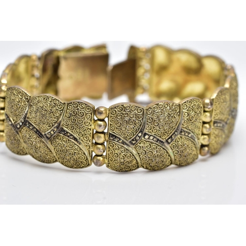 20 - A SILVER GILT MARCASITE WIDE LINK BRACELET, designed with six wavy edge textured links, set with mar...