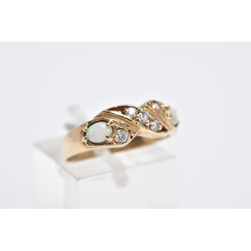 21 - A 9CT GOLD OPAL RING, of a crossover design, set with five circular cut colourless cubic zirconia st...
