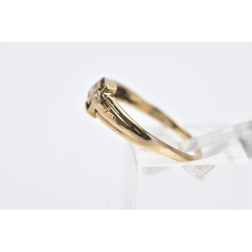 22 - A YELLOW METAL SINGLE STONE RING, designed with a central collet mounted circular cut colourless sto...