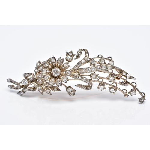 25 - A GOLD VICTORIAN DIAMOND FLOWER SPRAY BROOCH, mounted en tremblant, the larger old cushion cut diamo...