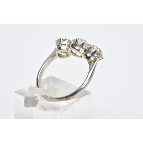 26 - A LATE VICTORIAN TO EARLY TWENTIETH CENTURY THREE STONE DIAMOND RING, centre old cushion diamond est...