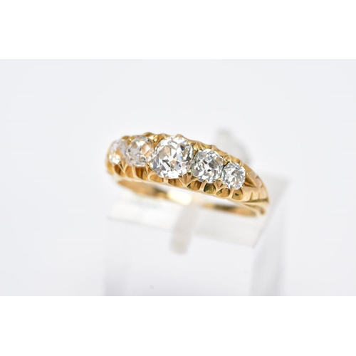 29 - A GOLD VICTORIAN GRADUATED HALF HOOP DIAMOND RING, old cushion cut diamonds graduating in size to en...