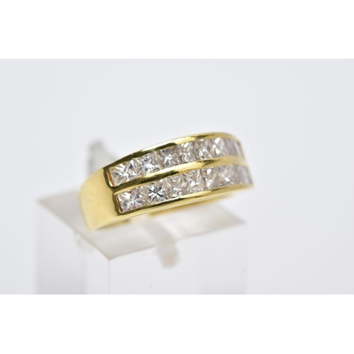 31 - A MODERN 18CT GOLD DOUBLE ROW DIAMOND RING, two rows of princess cut diamonds slightly tapering in s...