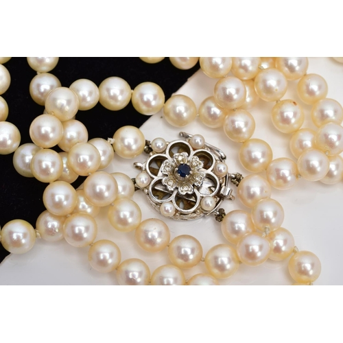 35 - A CULTURED PEARL NECKLET, two strands of cultured pearls, individually knotted on a white cord, each...